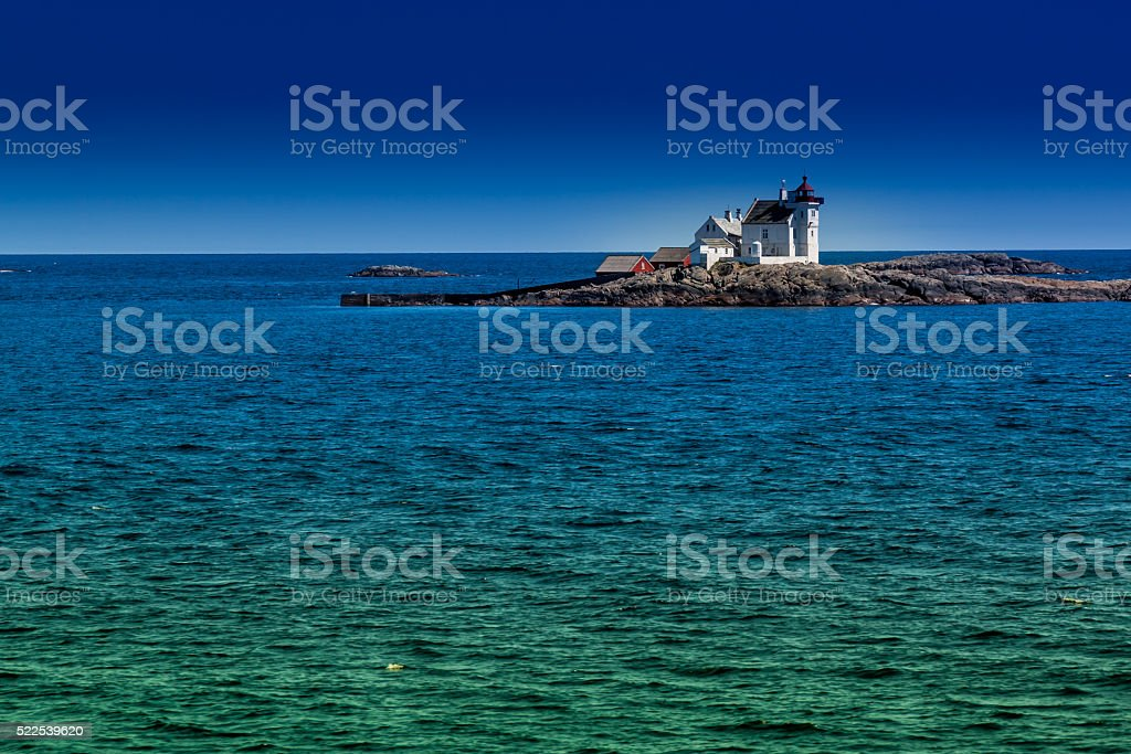Lighthouse in nice colored sea stock photo