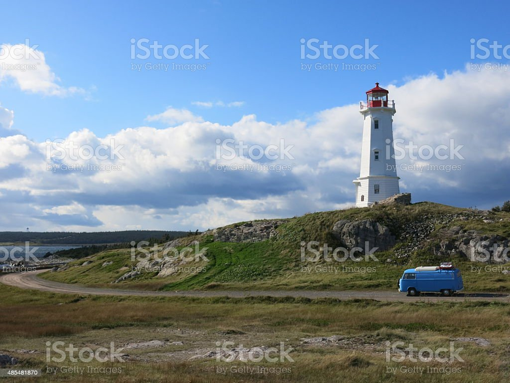 Lighthouse in Nova Scotia with VW bus stock photo