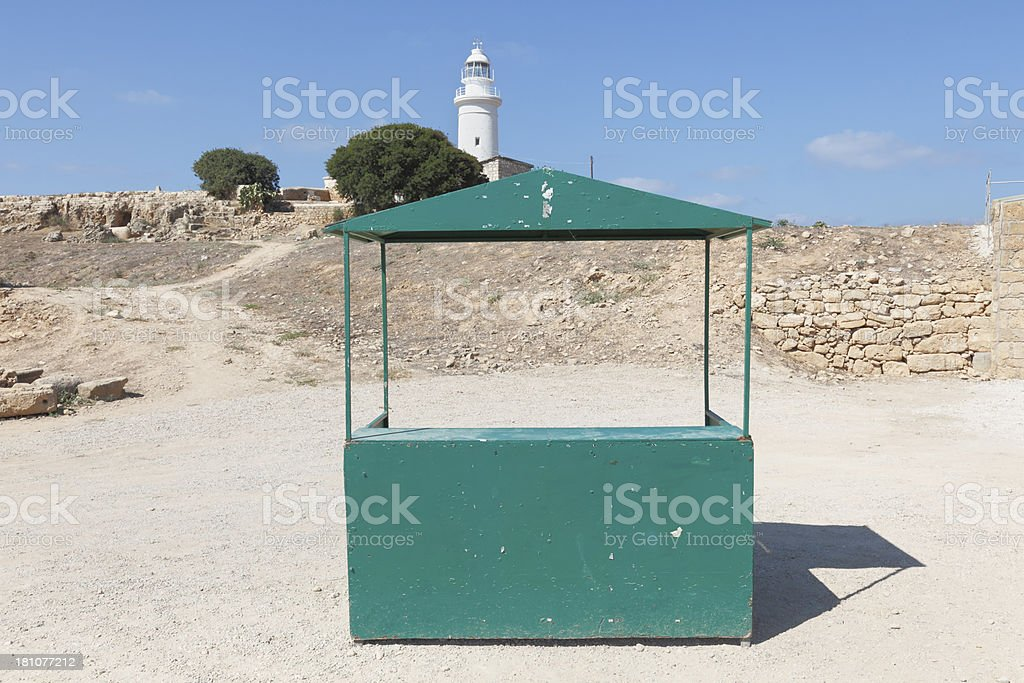 lighthouse in Paphos archeological site empty green information booth  Cyprus royalty-free stock photo