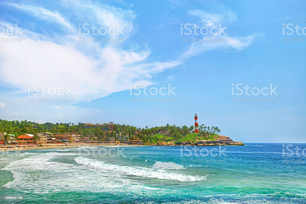 Lighthouse in the distance of Kovalam beach in Kerala India stock photo
