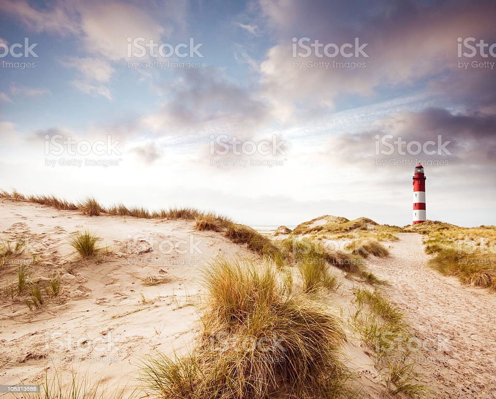 Lighthouse in the dunes stock photo