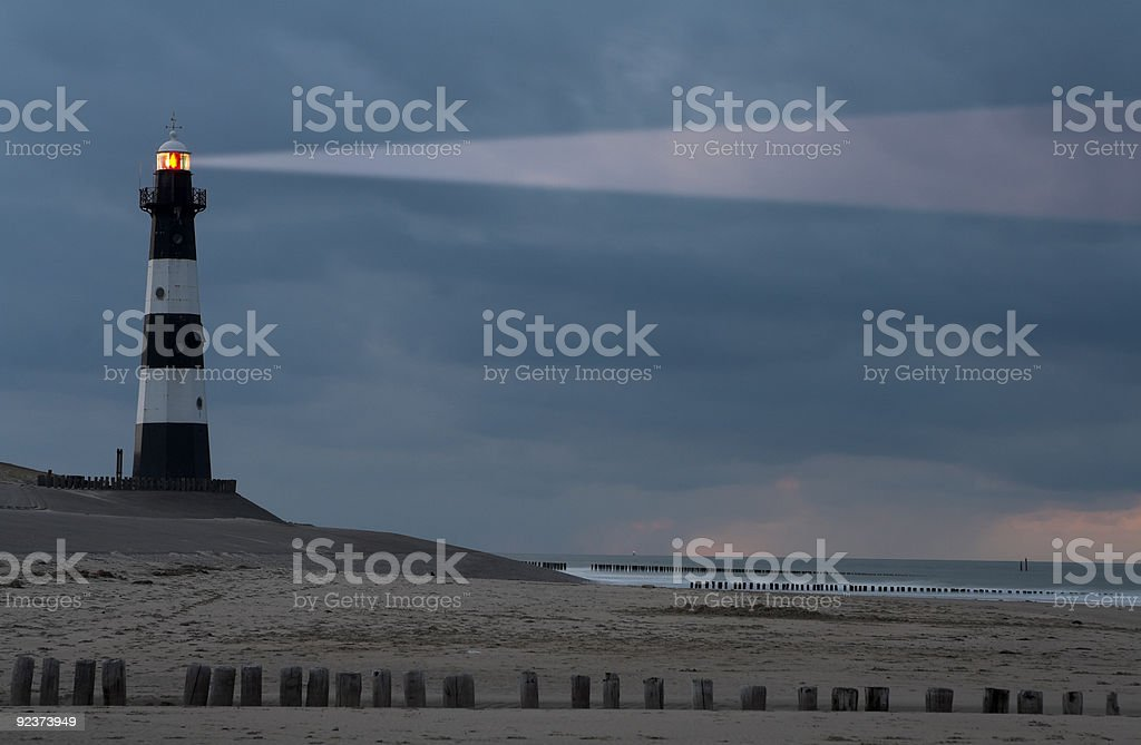Lighthouse in the dusk stock photo