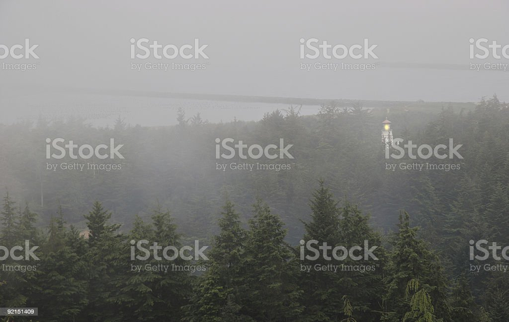 Lighthouse in the Fog royalty-free stock photo