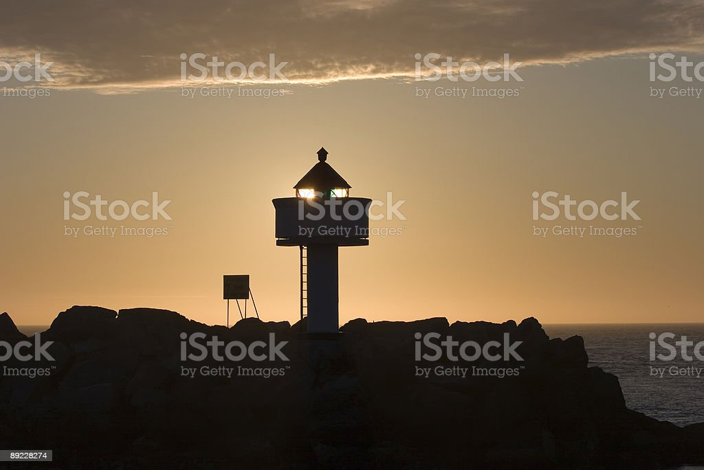 Lighthouse in the midtnight sun royalty-free stock photo