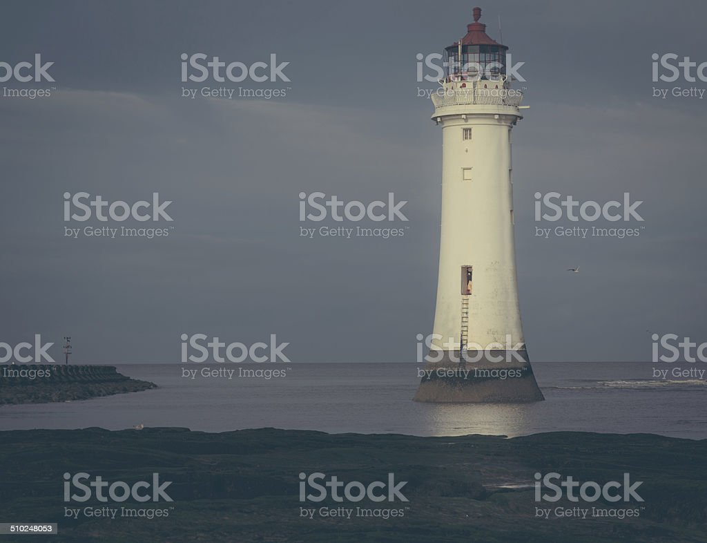 Lighthouse in the mist stock photo