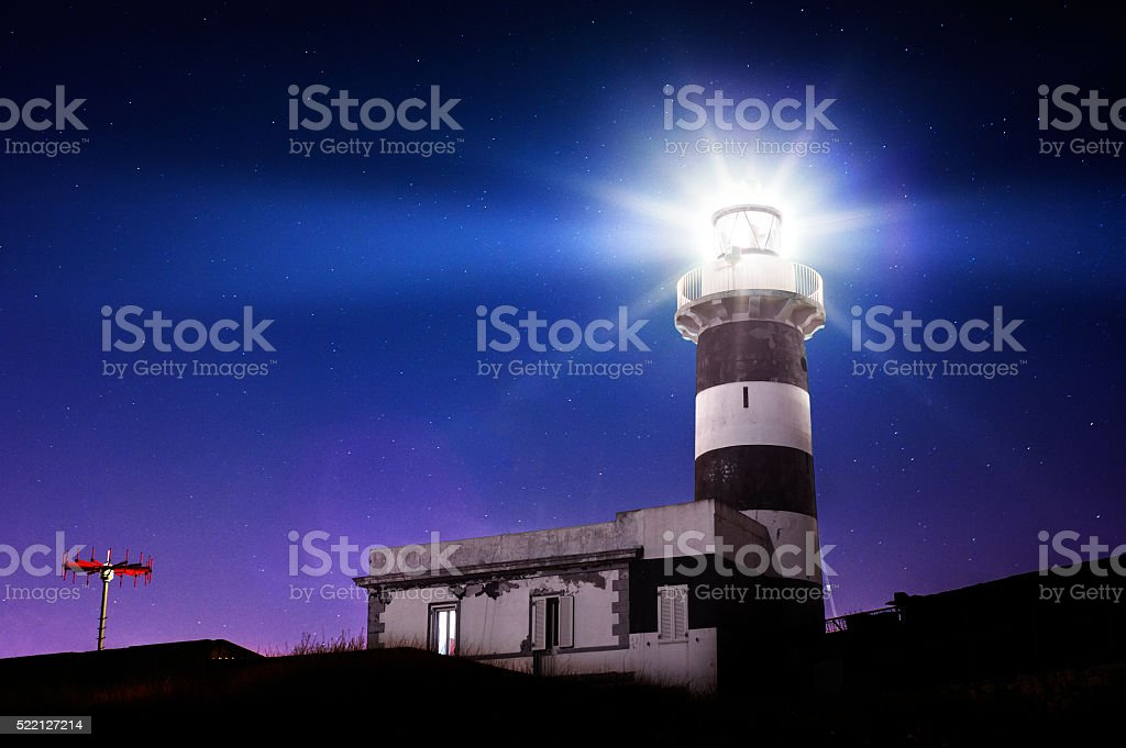 Lighthouse in the night stock photo