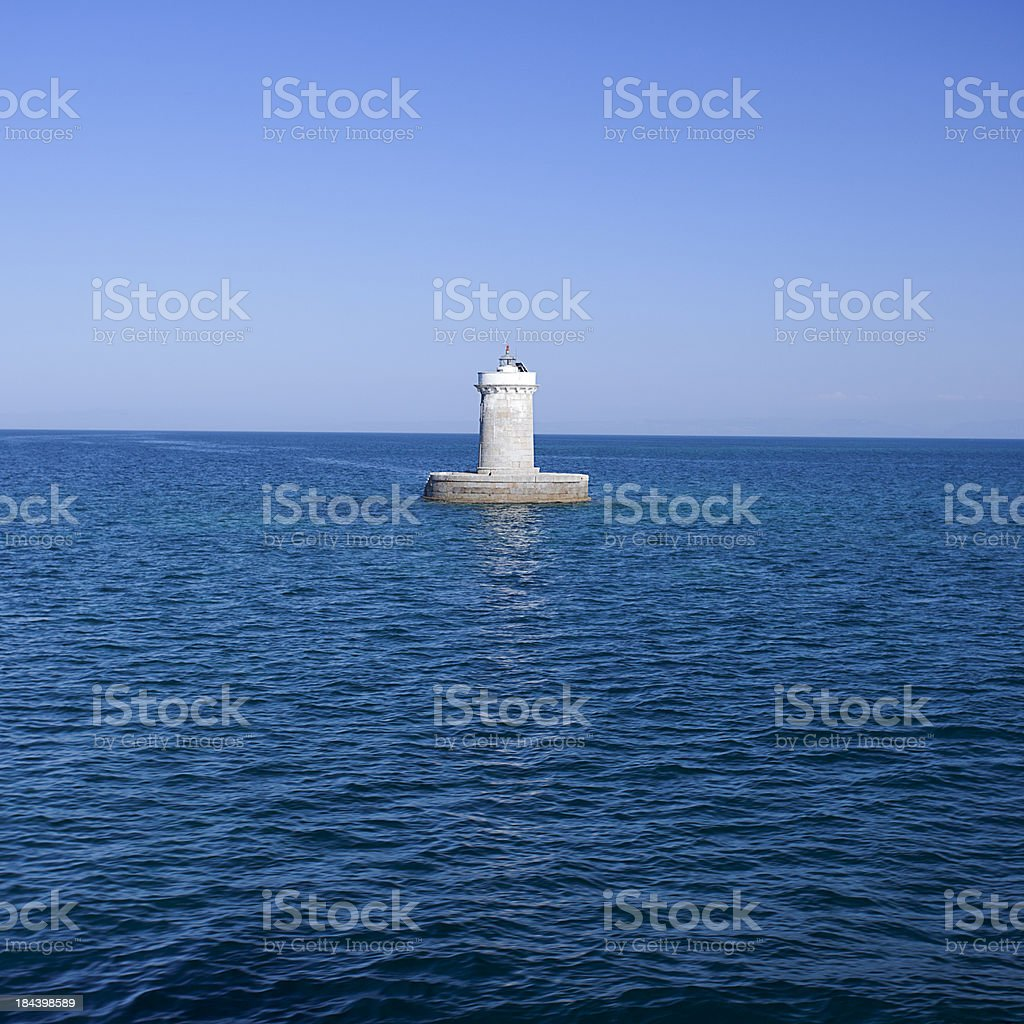lighthouse in the sea royalty-free stock photo