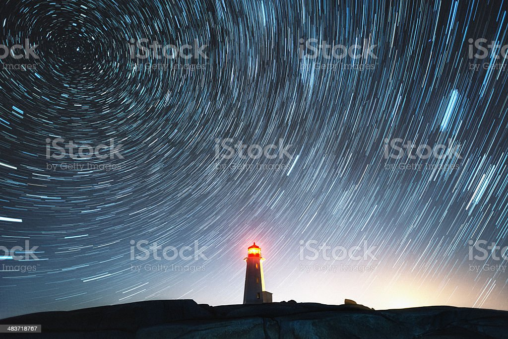 Lighthouse in the Stars stock photo