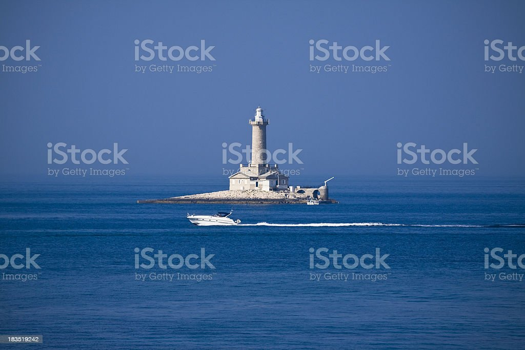 lighthouse in the sun royalty-free stock photo