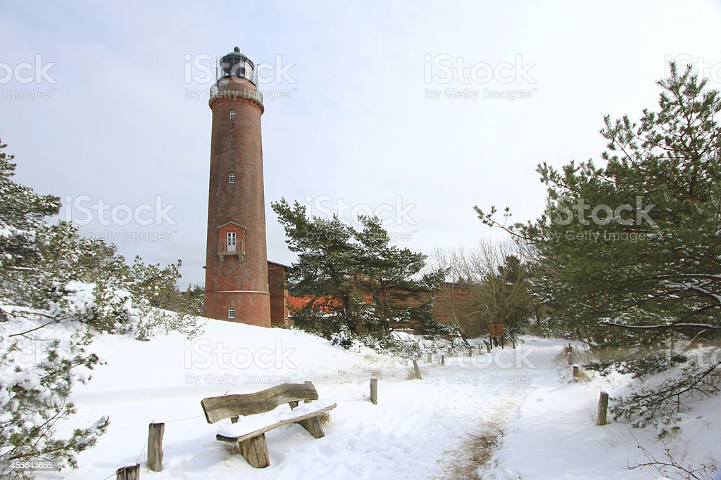 Lighthouse in winter stock photo