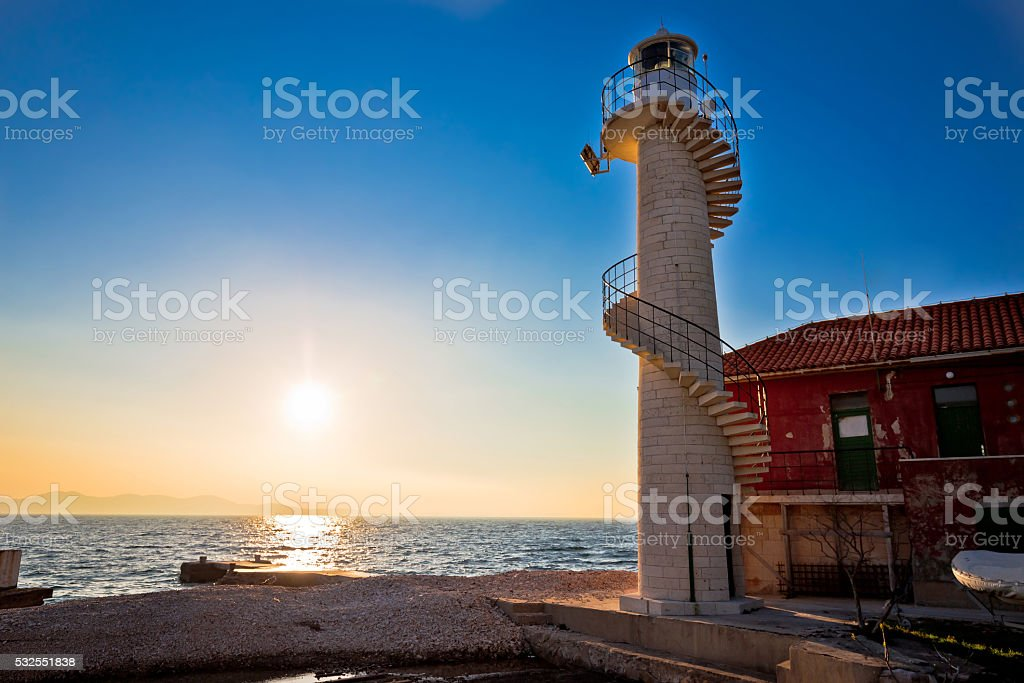 Lighthouse in Zadar at sunset stock photo