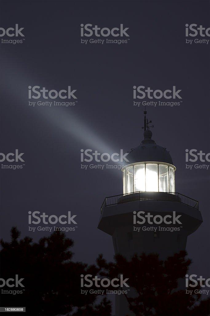 Lighthouse light beam at night royalty-free stock photo