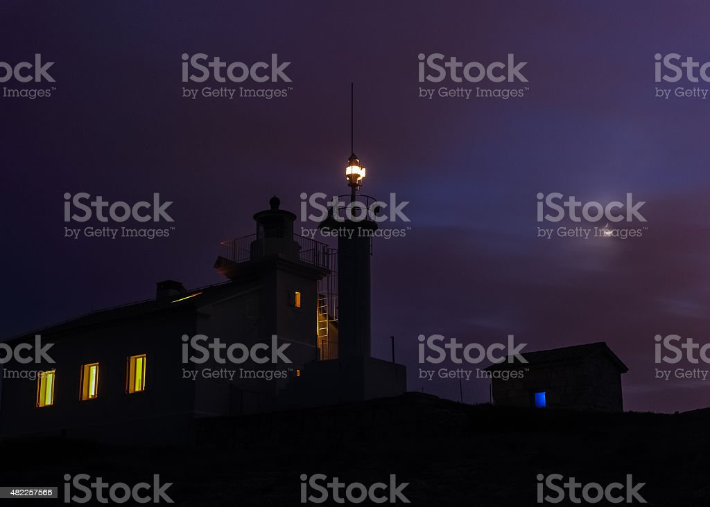 Lighthouse Marlera at night stock photo