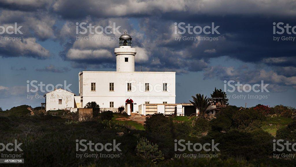 Lighthouse of cala del faro bay , Sardinia, Italy stock photo