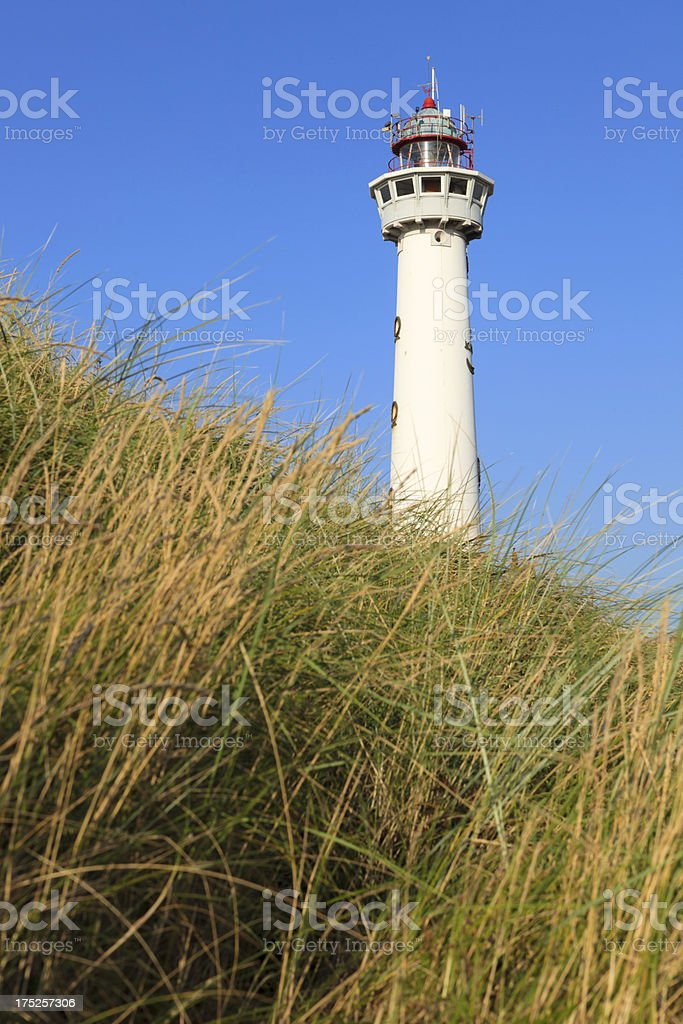 lighthouse of Egmond aan Zee against a clear blue sky royalty-free stock photo