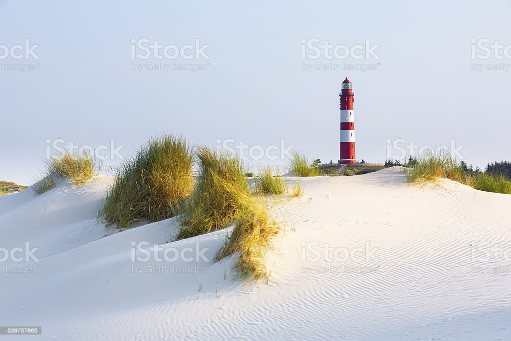 Lighthouse on a dune stock photo