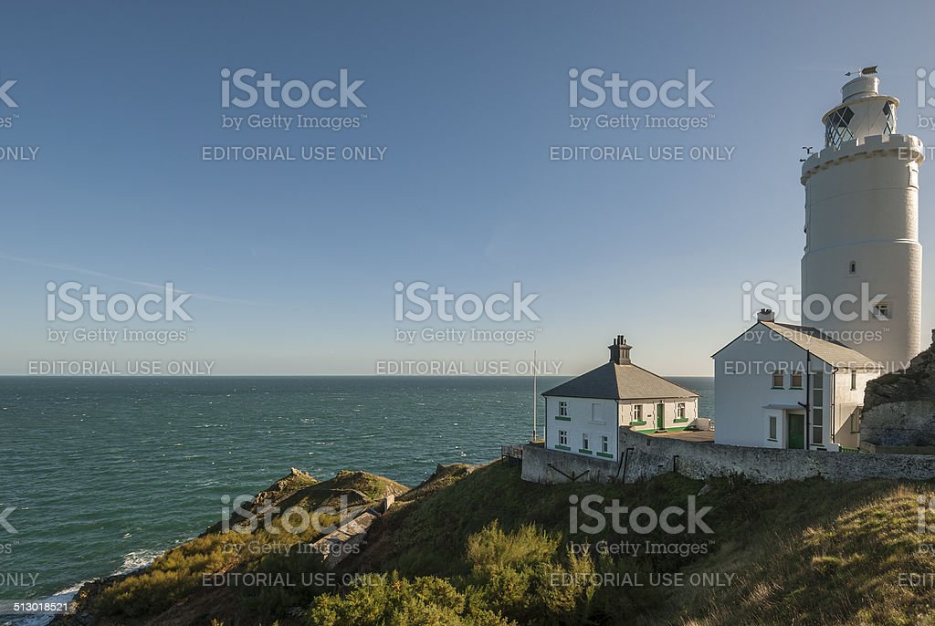 Lighthouse on a Headland stock photo