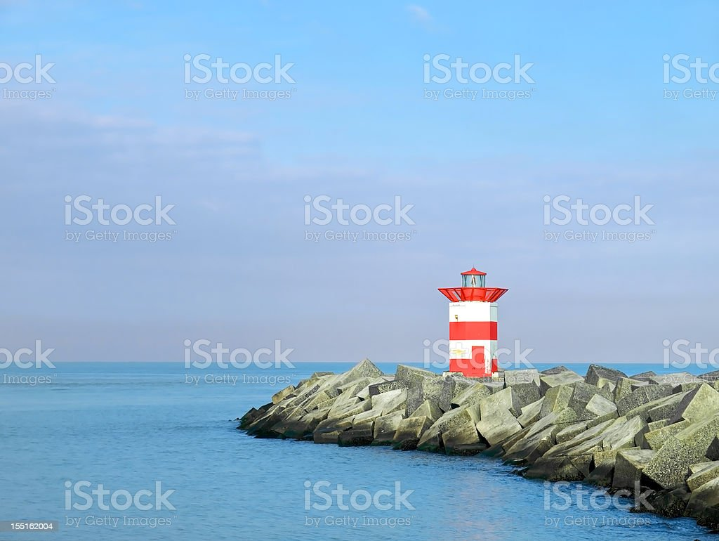 Lighthouse on a jetty royalty-free stock photo