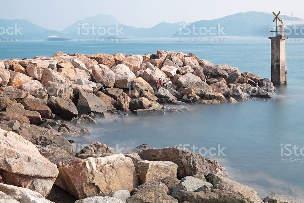 Lighthouse on a Rocky Breakwall royalty-free stock photo