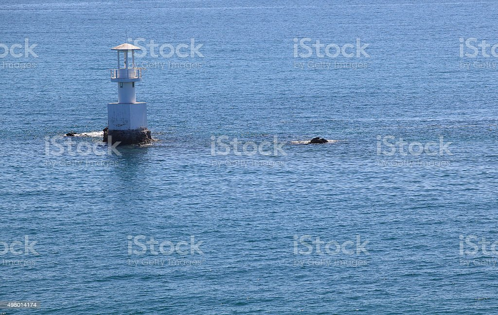 Lighthouse on a sunny day with blue sky. stock photo
