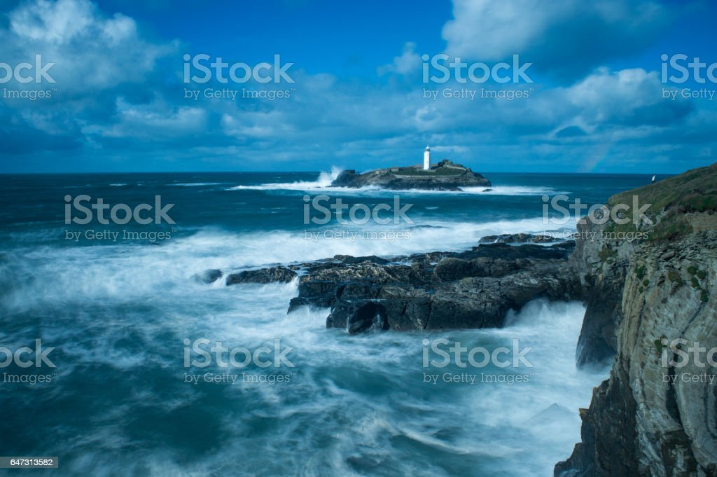 Lighthouse on a Windy Day in Cornwall stock photo