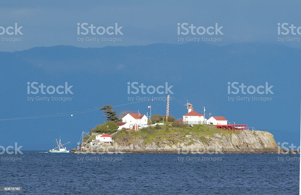 Lighthouse on an Island royalty-free stock photo