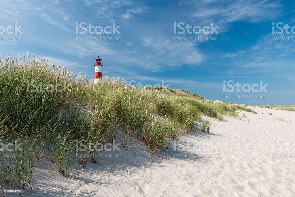 Lighthouse on dune horizontal stock photo