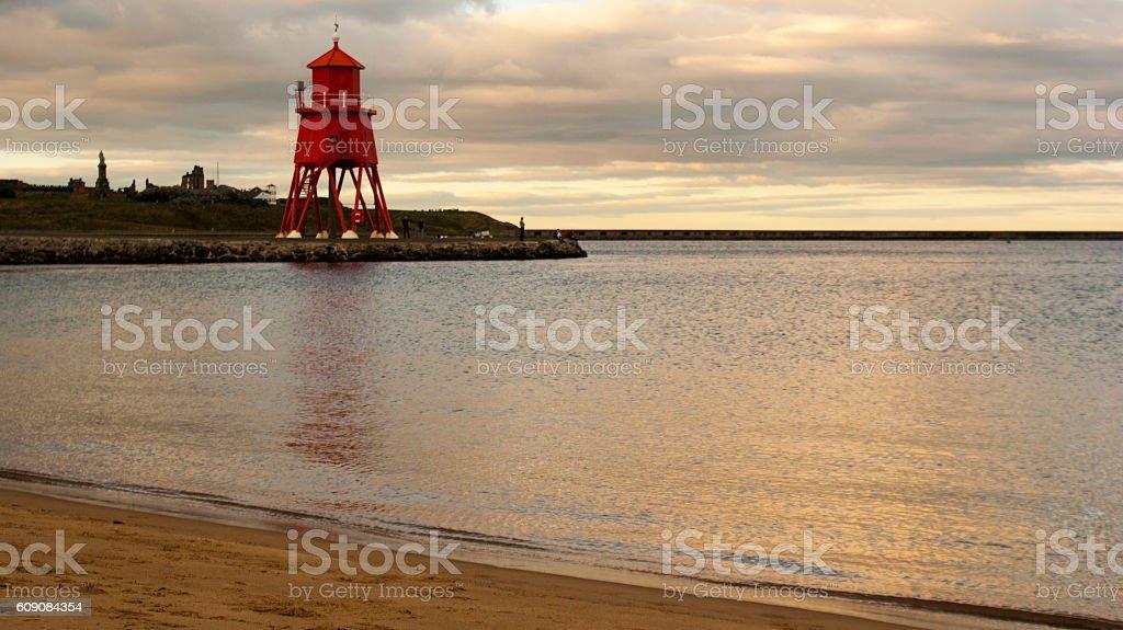 Lighthouse on groyne stock photo