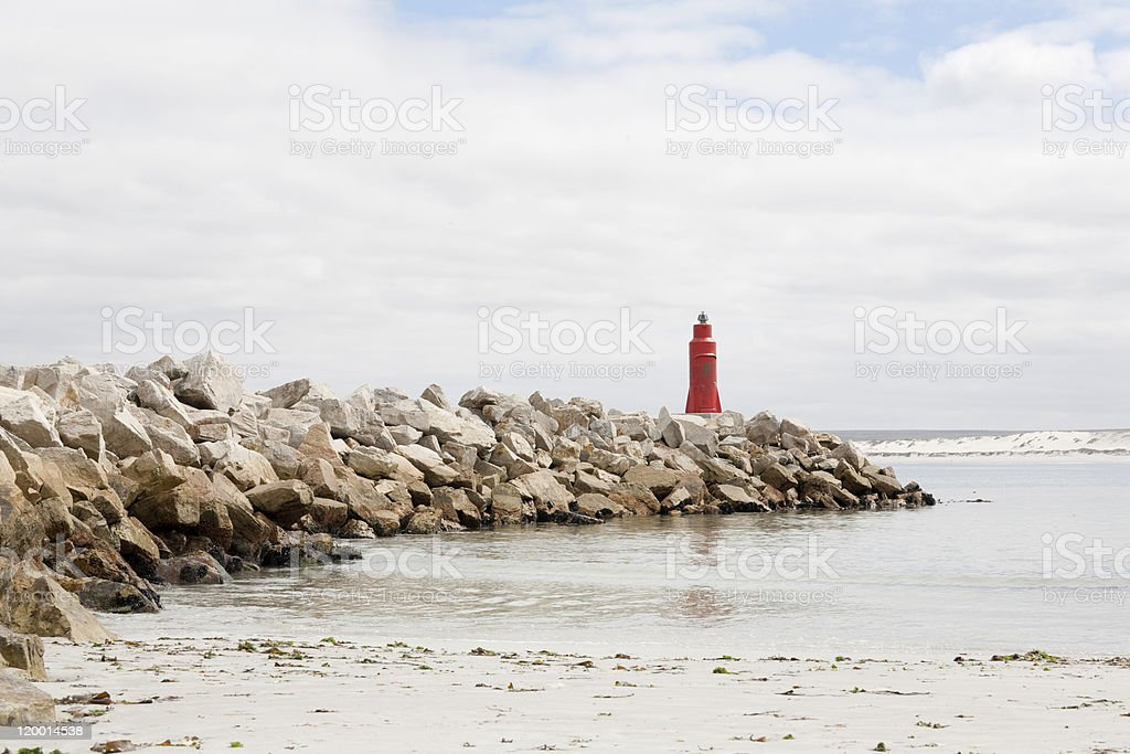 Lighthouse on harbor wall stock photo