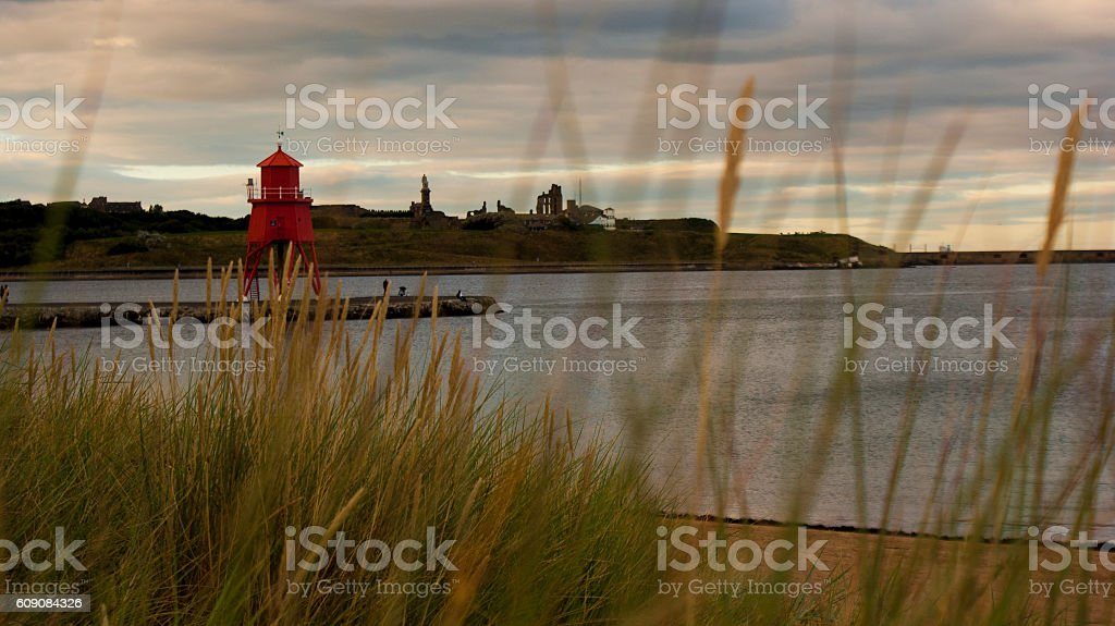 Lighthouse on headland stock photo