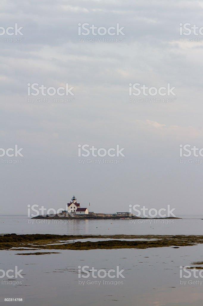 Lighthouse on Island of the New England Coast royalty-free stock photo