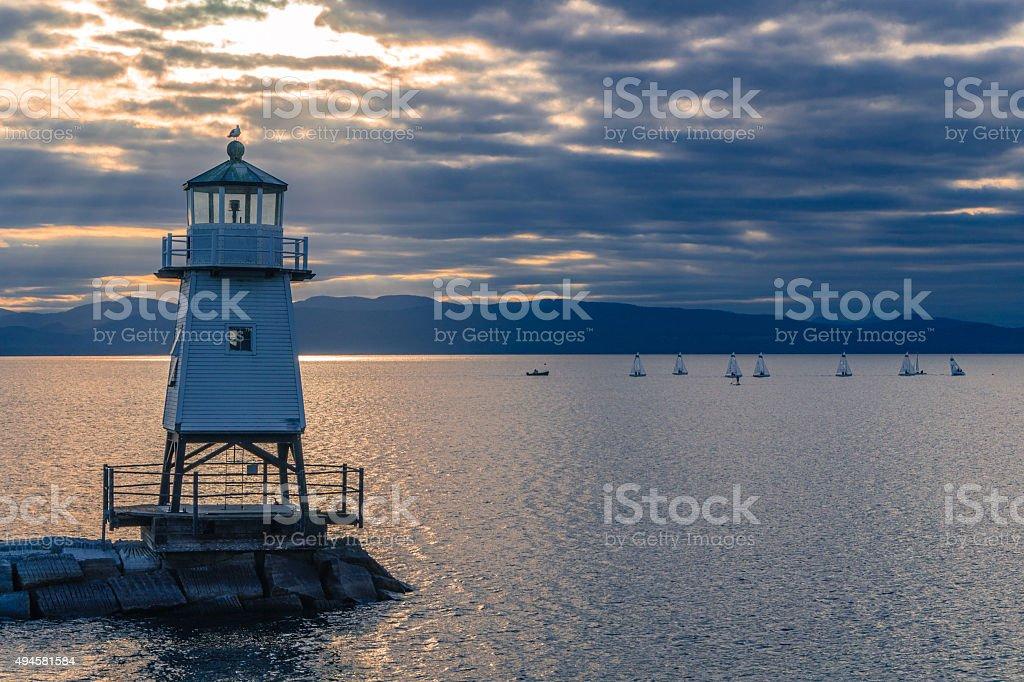 lighthouse on lake breakwater stock photo