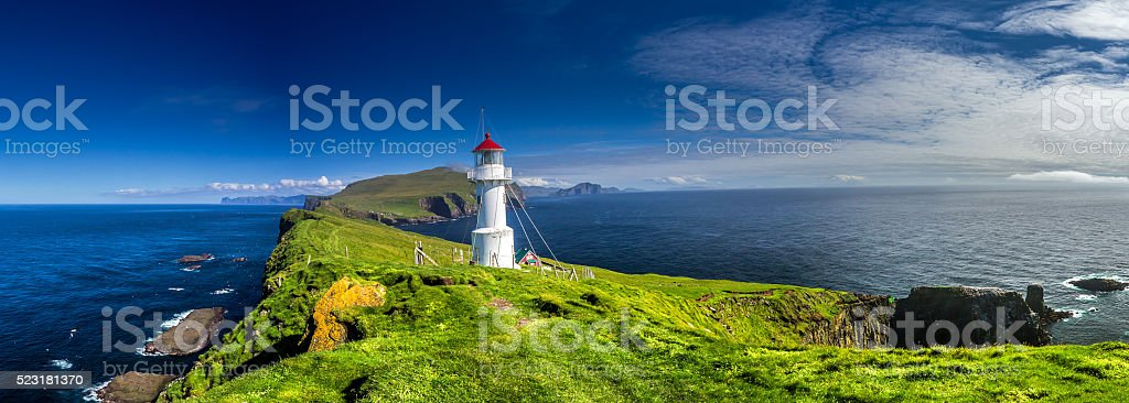 Lighthouse on Mykines, Faroe islands stock photo