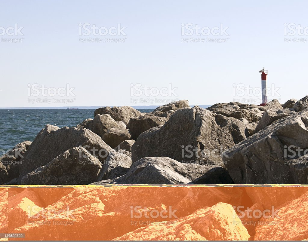 Lighthouse on Pier, Rocky Shoreline stock photo