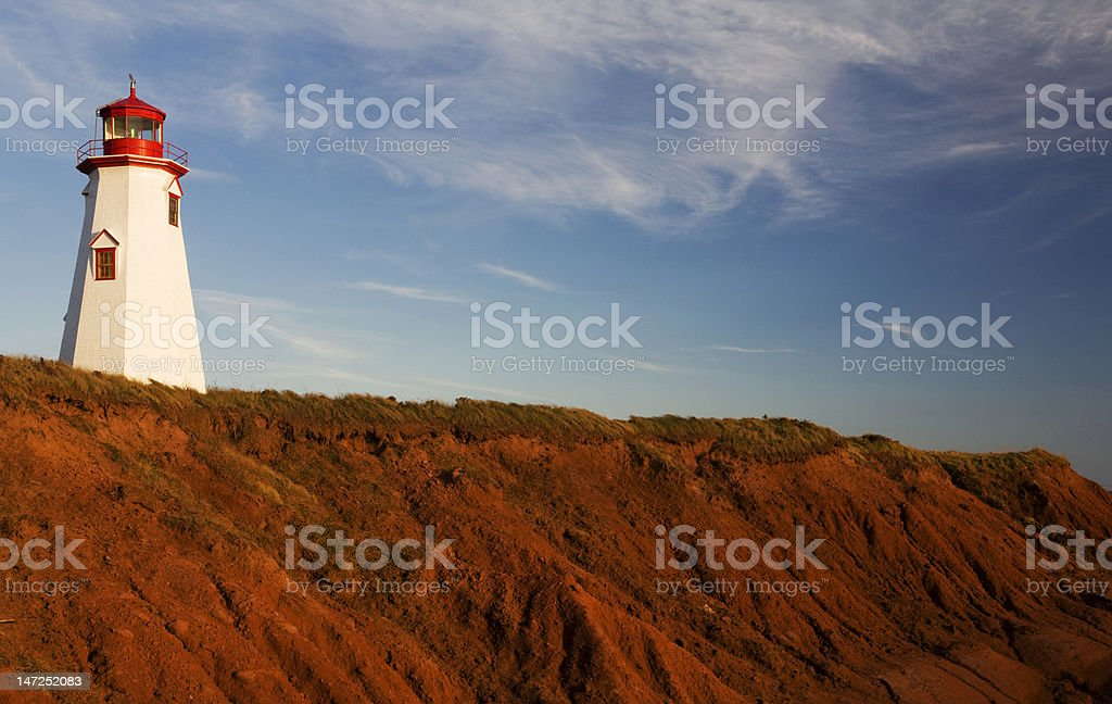 Lighthouse on red coast stock photo