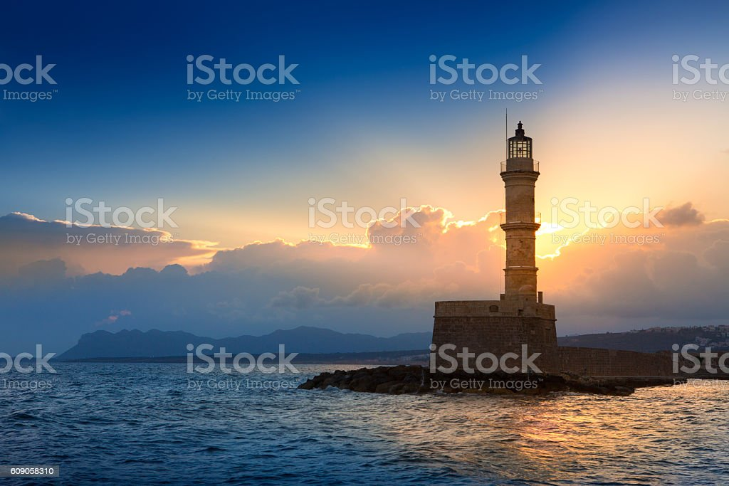 Lighthouse on sunset. Chania, Crete, Greece. stock photo