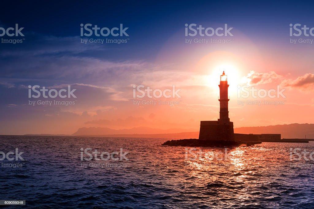 Lighthouse on sunset. Chania, Crete, Greece. stock photo