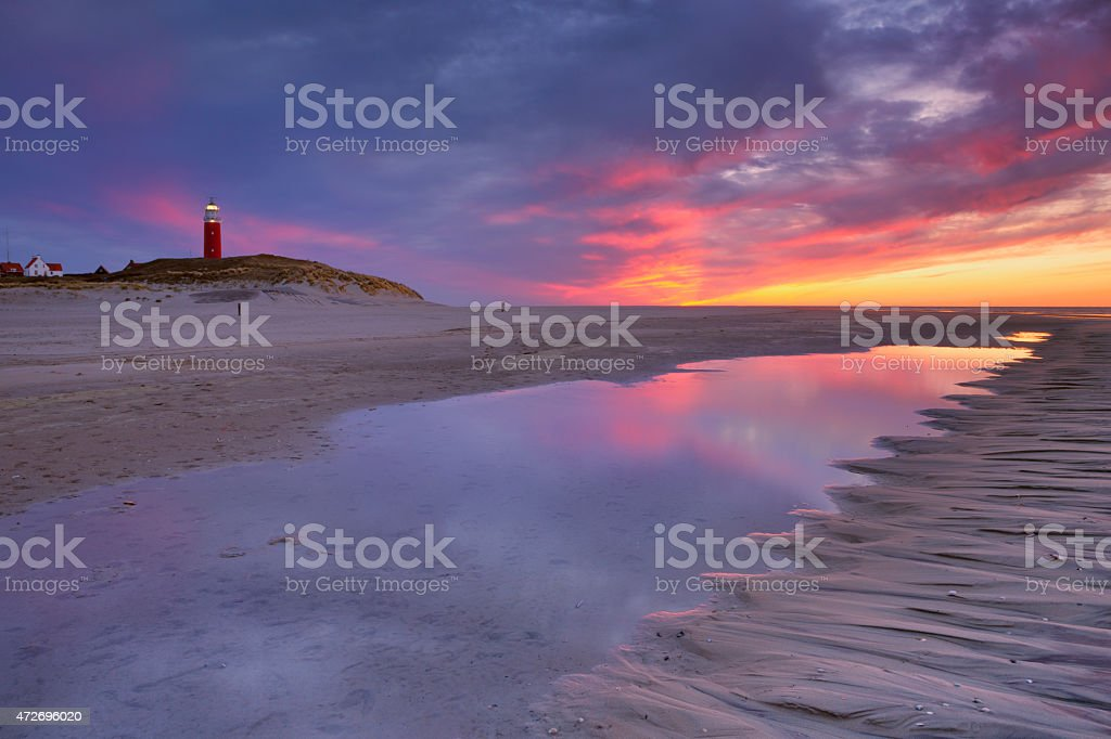 Lighthouse on Texel island in The Netherlands at sunset stock photo