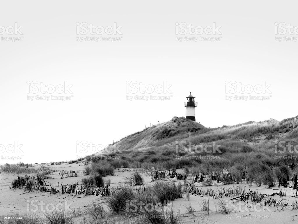 Lighthouse on the beach stock photo