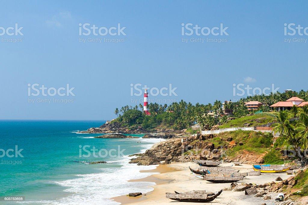 Lighthouse on the cape in Arabian Sea, beach, fishing boats stock photo