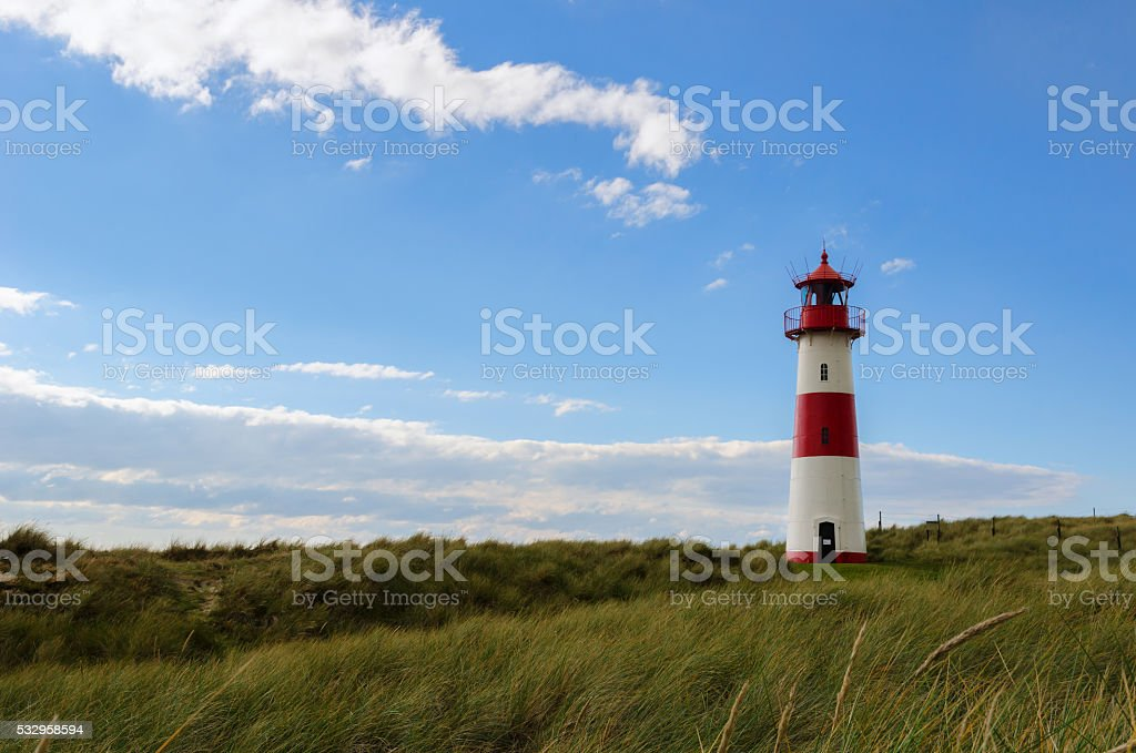 Lighthouse on the Dunes stock photo