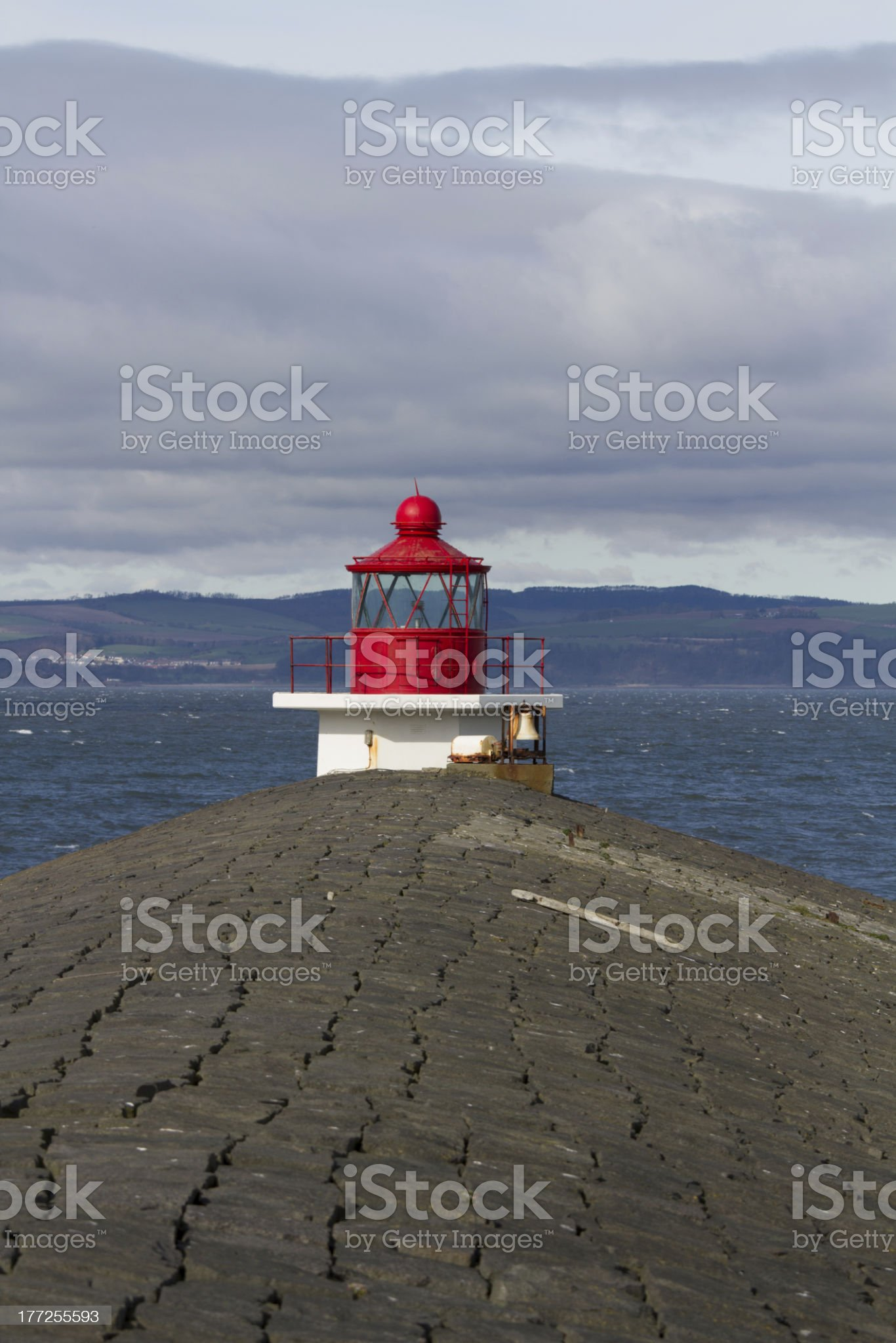 Lighthouse on the end of breakwater royalty-free stock photo