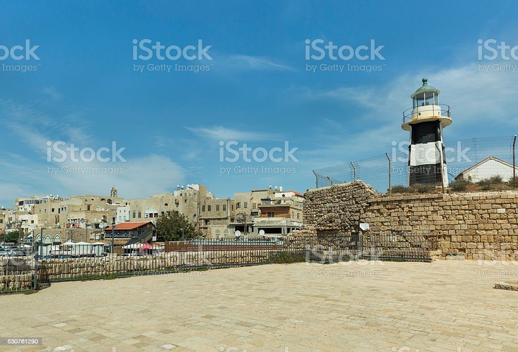 Lighthouse on the fortress wall stock photo