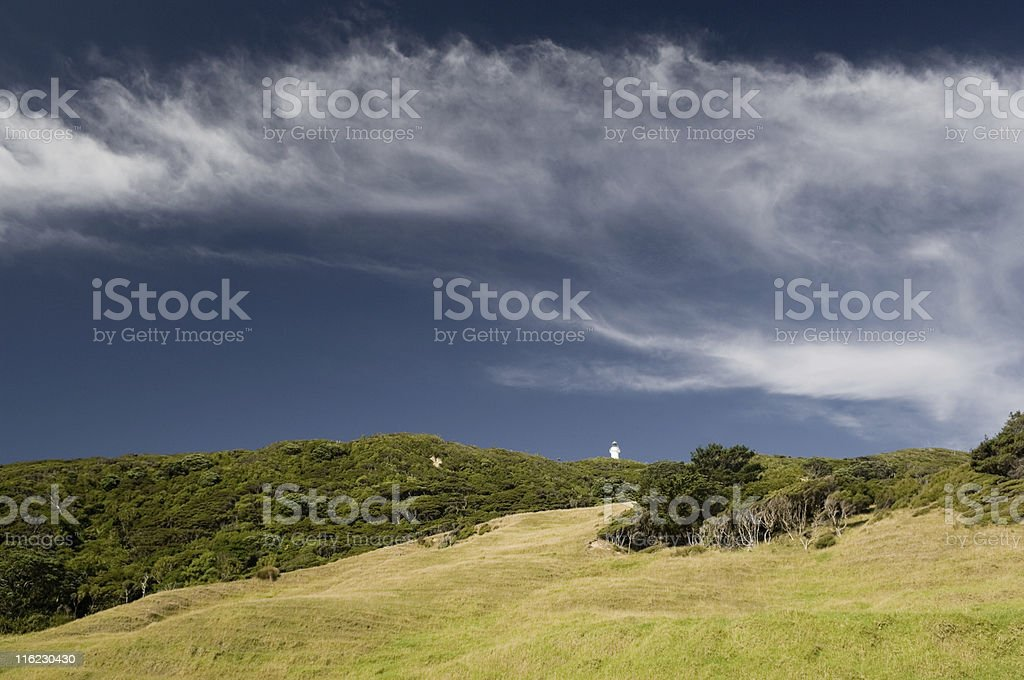 Lighthouse on the Hill under Cirrus Cloud stock photo