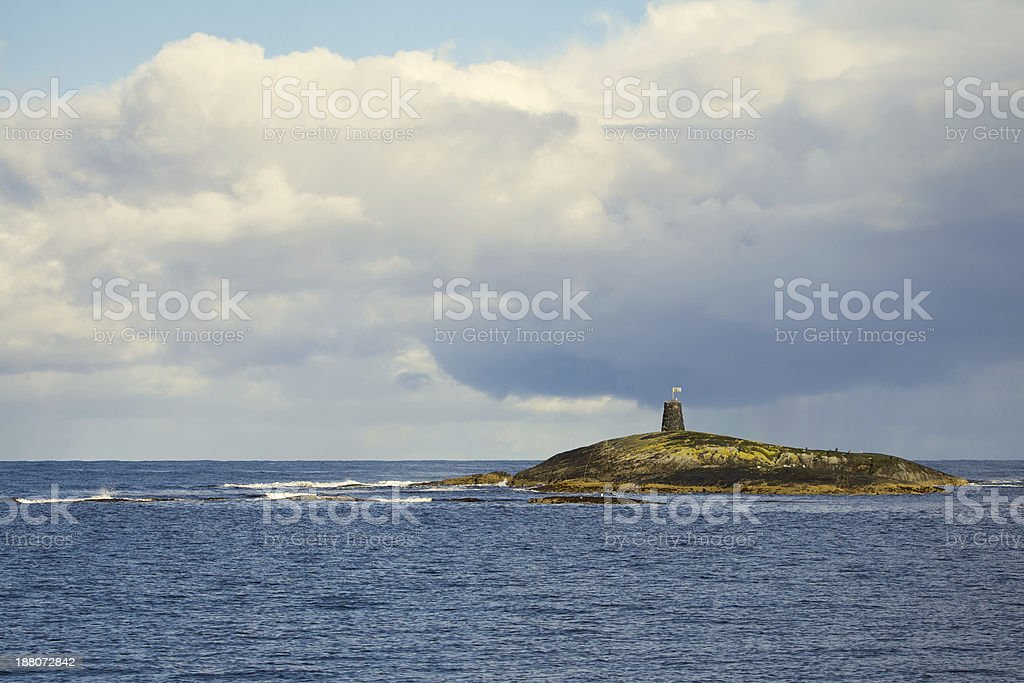 lighthouse on the rock royalty-free stock photo
