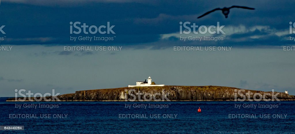 Lighthouse on the rocks stock photo