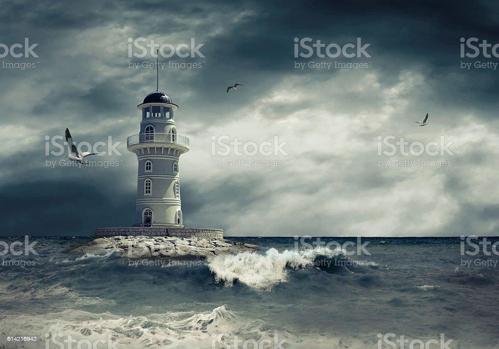 Lighthouse on the sea under sky stock photo