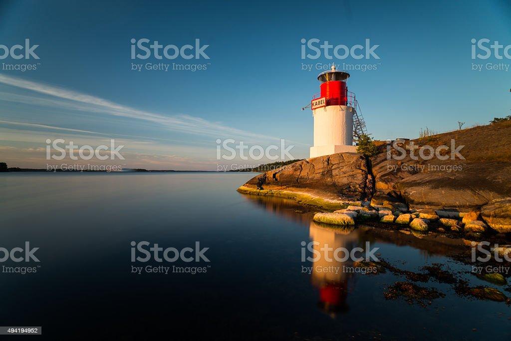 Lighthouse on the Swedish archipelago island at sunset stock photo
