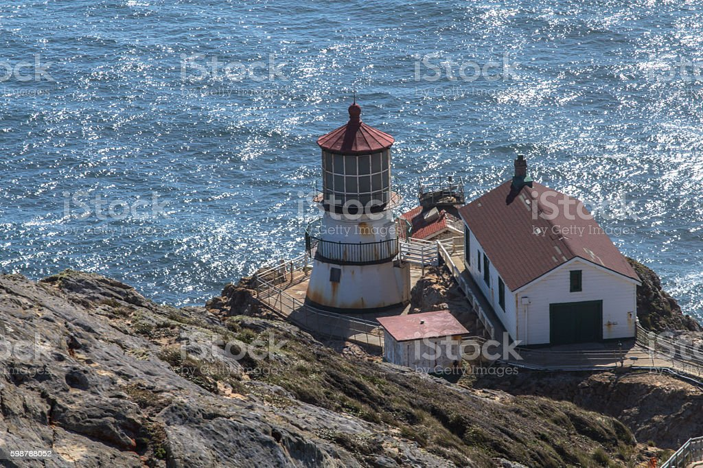 Lighthouse on water stock photo