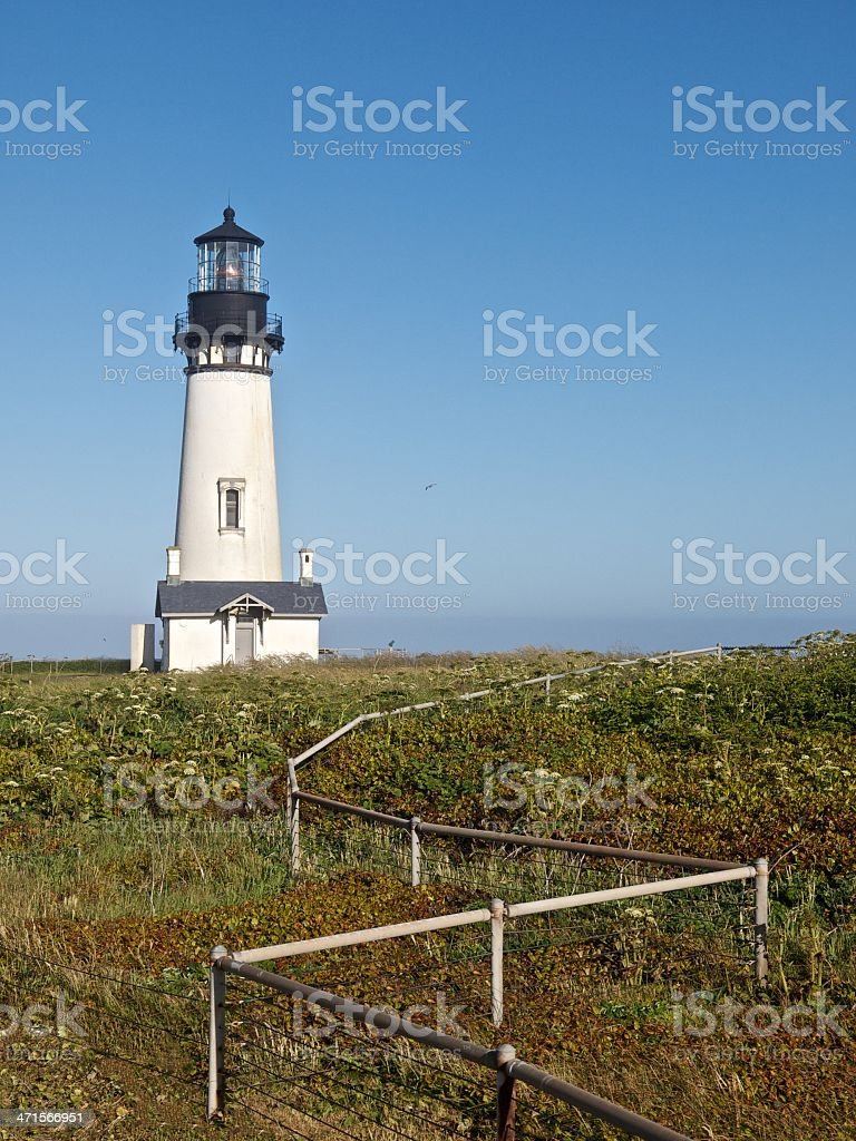 Lighthouse Oregon Yaquina Head Pacific Ocean Front Fence stock photo